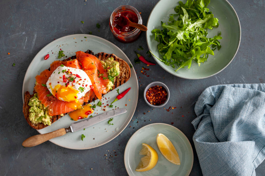 Poached egg with Salmon and Avo on Sour Bread - food photography